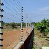 Compound wall with solar-fencing